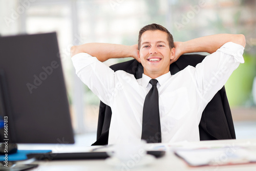 young businessman relaxed in office