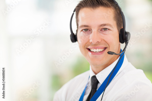 male call centre employee wearing a headset