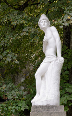 Classical nude male statue in a garden