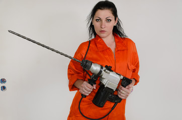 Competent woman with a masonry drill