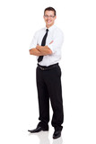 young businessman standing with arms crossed