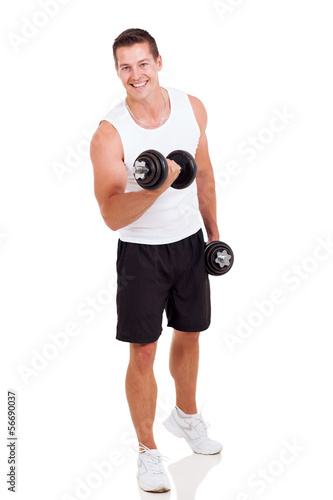 young man exercising with dumbbells