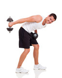 handsome young man using dumbbells