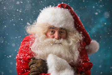 Photo of frozen Santa Claus outdoors in snowfall