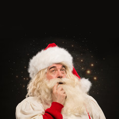 Santa Claus at night making magic