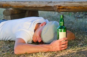 Drunk man lying on the ground