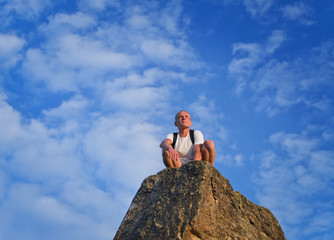 Man sitting on top of a rocky pinnacle