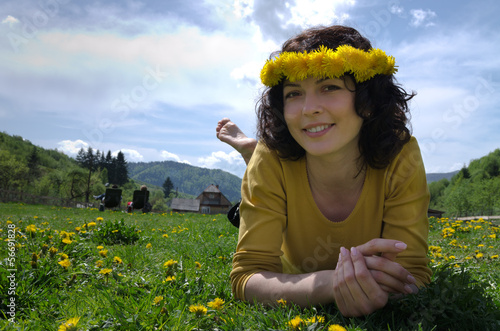 Close up of a young woman lying in a meadow