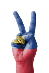 Hand making the V sign, Liechtenstein flag painted