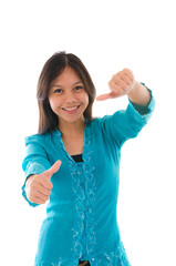 Cute young Muslim girl giving a thumb up sign over white backgro