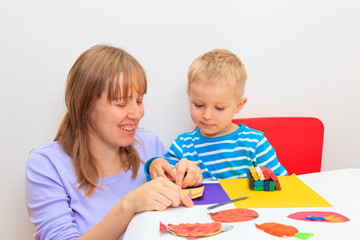mother and son with play dough