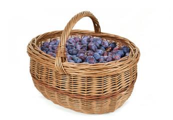 ripe plums in basket