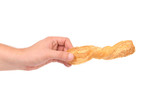 Hand holds of puff pastry stick