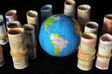 Planet Earth and Rolled Money