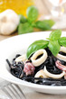 Fresh black squid ink pasta with seafood and basil