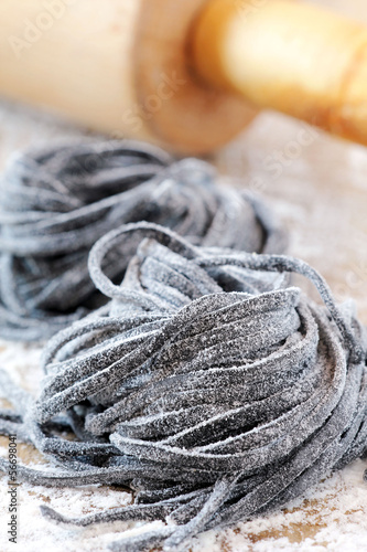 Homemade fresh black squid ink pasta nests