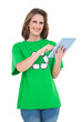 Happy environmental activist using tablet looking at camera