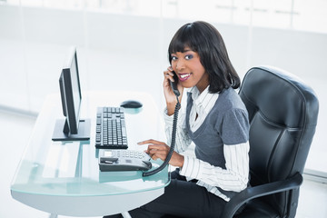 Smiling classy businesswoman answering the phone