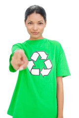Relaxed model wearing recycling tshirt pointing at camera