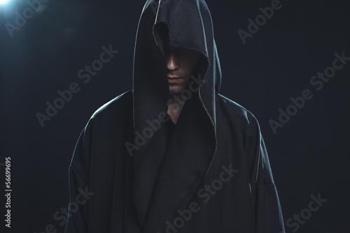 Portrait of man in a black robe