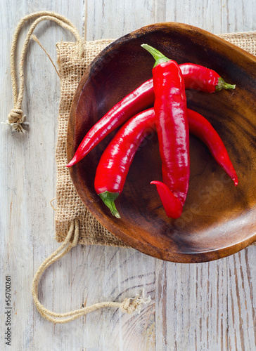 Chili pepper on wooden table