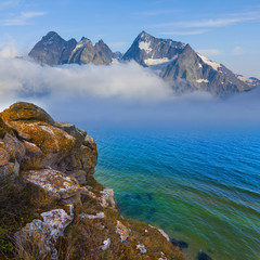 mountains beyond a sea