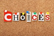 The word Choices on a cork notice board