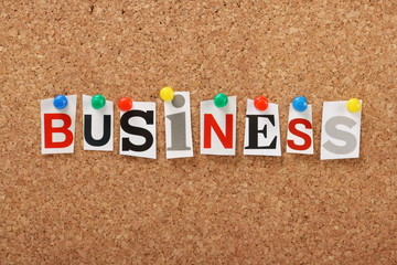 The word Business on a cork notice board