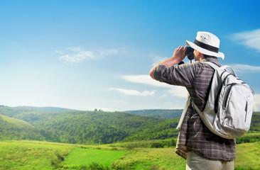 Explorer watching nature through binoculars