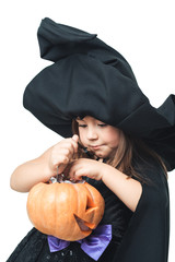 little witch considers collected candy