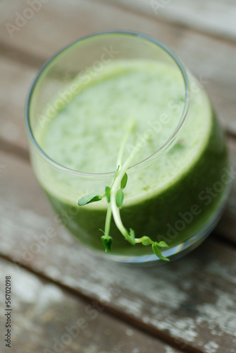 green healthy smoothie with pea shoots