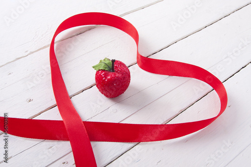 christmas ornamente with red ribbon on background