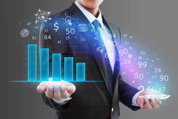 Businessman holding smartphone and showing graph