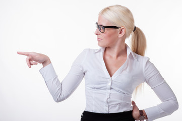 Businesswoman is showing something with her finger
