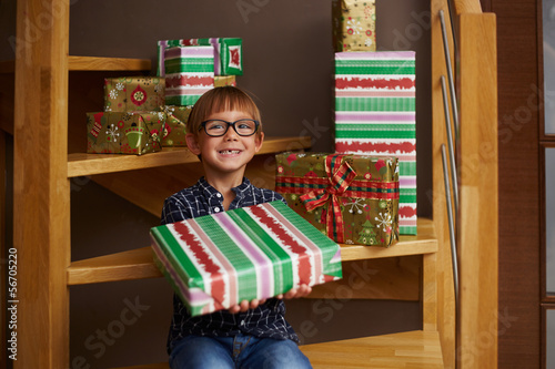 Smiling boy ready to open Christmas presents
