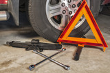 Car jack, lug wrench and safety triangle