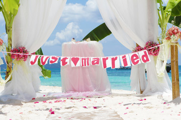 wedding arch - tent - decorated with flowers on beach, tropical
