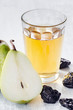 Healthy detox meal of apple juice, pear and prunes