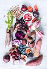 Assorted purple toned fruits and vegetables as a collection