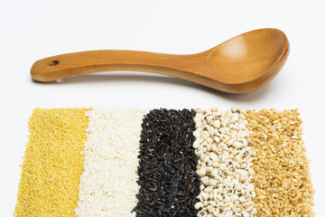 mixed rices and wooden tablespoon