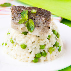 Italian risotto with rice, green peas, mint and white fish