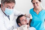 Dental surgery. There's a dentist, his assistant and the patient