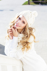 Portrait of young beautiful woman wearing sweater and hat
