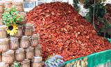 immense mountain of dried red ripe tomatoes for sale