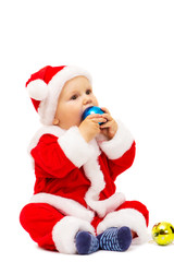 Small Santa with toys and spheres in hands