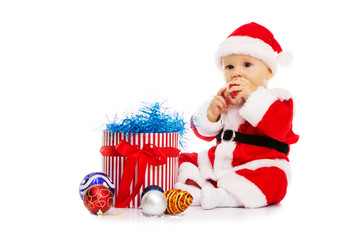 The boy in an image of Santa Claus sits