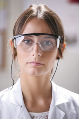 Portrait of scientific woman with glasses.