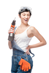 cheerful female worker holding drill