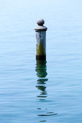 Rusty pole in water