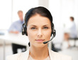 female helpline operator with headphones